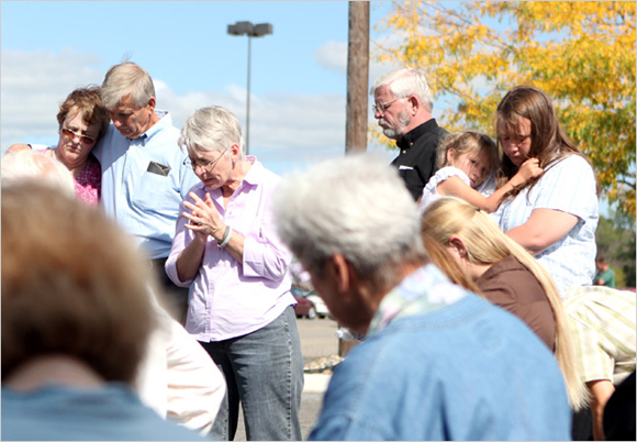 Mourners at Jim Pouillon's Vigil Praying