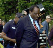 Alan Keyes off to the slammer.